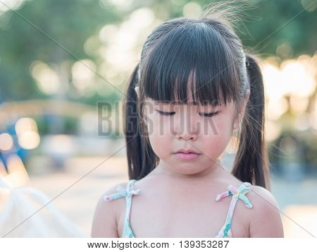 Portrait of a cute little girl crying action sunset light