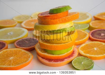 Slices Of Various Citrus Types Arranged In A Colorful Stack