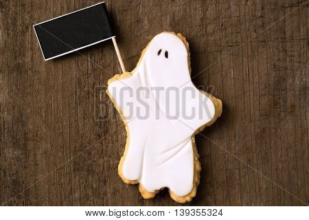 Ghost with blackboard on brown background, close up
