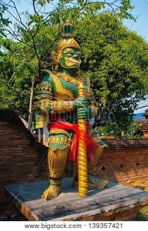 Sculpture By The Water In Buddhist Temple. Chiangmai.