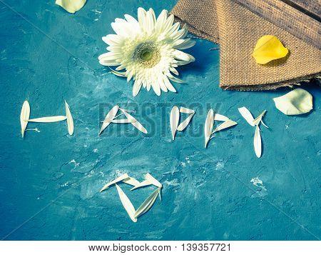 Word Happy Written With Petals