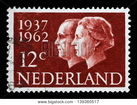 ZAGREB, CROATIA - JULY 03: A stamp printed in Netherlands shows portraits of Queen Juliana (1909-2004) and Prince Bernhard (1911-2004), circa 1962, on July 03, 2014, Zagreb, Croatia