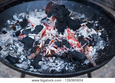 Burning charcoal fire for cooking on barbakoa