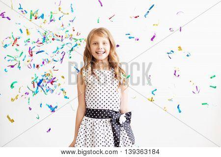 Little Girl Jumping And Having Fun Celebrating Birthday