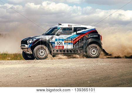 Filimonovo Russia - July 11 2016: closeup of race car driving on dusty road during Silk way rally