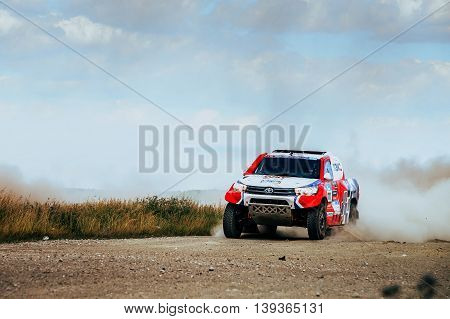 Filimonovo Russia - July 11 2016: rally Toyota car rides on dusty road during Silk way rally