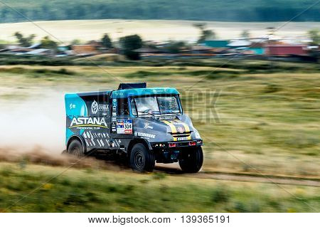 Filimonovo Russia - July 11 2016: rally truck rides at high speed on a dusty road during Silk way rally