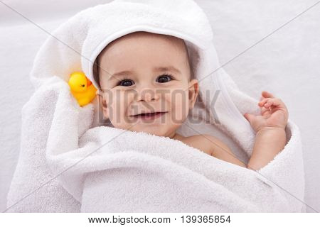 Adorable Baby Smiling Wrapped In White Towel With Yellow Duck