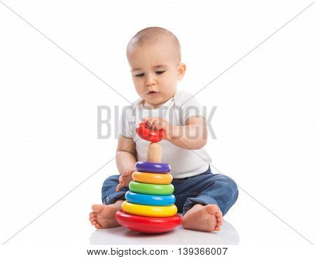 Baby holding and playing with education toys isoalted