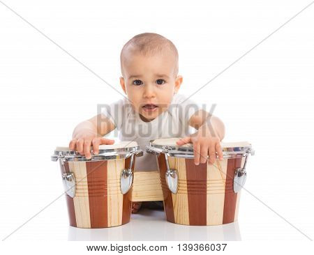 Funny smiling baby with bongos isolated, close up