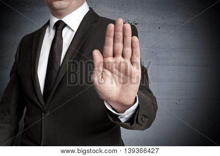 Handstop showed by businessman Background picture concept