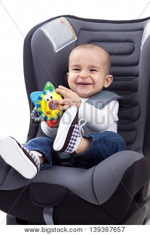 Baby Boy Sitting On Child's Car Seat, Isolated
