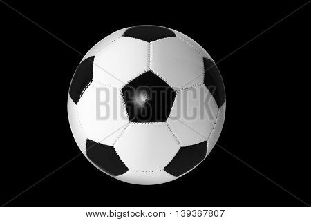 Black and white soccer ball isolated on black background.