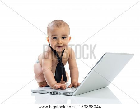 Baby and computer isolated on white, close up