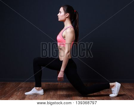 Young  fitness asian woman doing lunge with squats