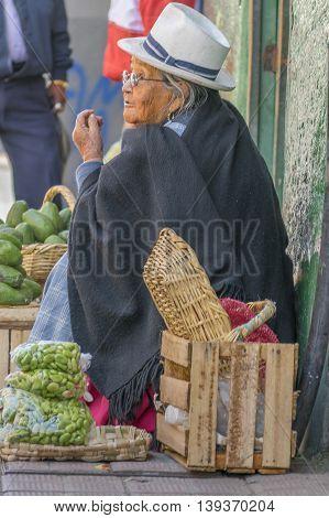 AZUAY, ECUADOR, OCTOBER - 2015 - Traditional old woman street vendor at historic center of Cuenca Ecuador.