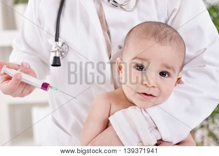 A Doctor Giving A Baby An Injection