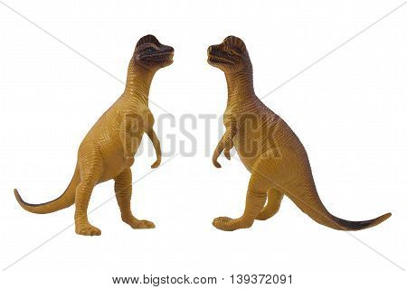 Isolated dilophosaurus dinosaur profile and angle view toy photo.