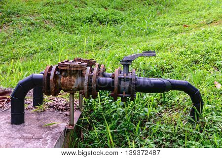 old leaked rusty country water supply system