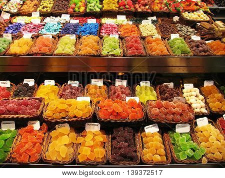 Colorful image of various sweets candied fruit jelly at market stall