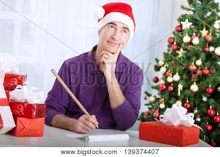 Senior Man Thinking About Wishes For Merry Christmas