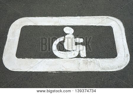Road markings for the disabled. Sign for disabled parking.