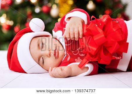 Santa Claus Baby Sleeping And Holding Present