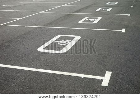 Road markings for the disabled. Diagonal image in the parking lot.