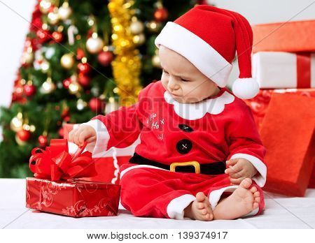 Cute Little Baby Santa Opening Gift For Christmas