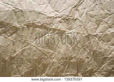 Brown crumpled paper background , grunge  old paper sheet texture for backdrop or overlay design