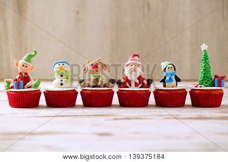 Group Of Christmas Cupcakes On Wooden Background
