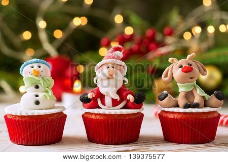 Three traditional decorated christmas cupcakes, christmas concept