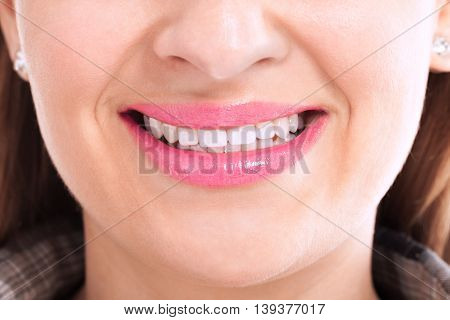 Girl smiling with healthy white teeth, health concept