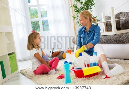 Happy Smiling Cute Daughter And Mom Cleaning Home