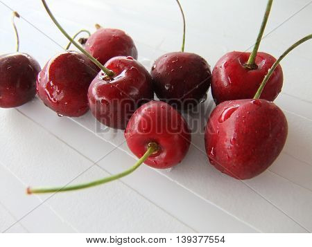 cherries. fruits in white plate on the table