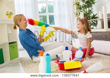Smiling Happy Family Playing With Cleaning Tool
