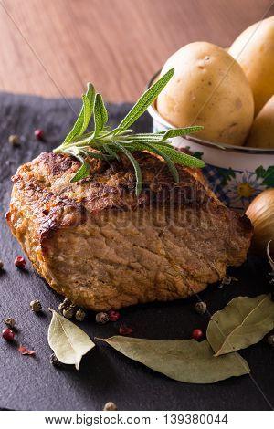 Baked Piece Of Pork Meat On Slate Stone