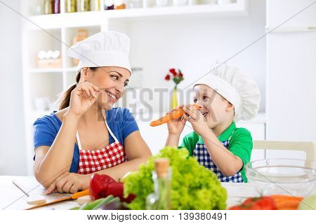 Beautiful Attractive Mother And Child Playing With Vegetables