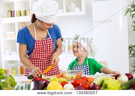 Beautiful Mother With Happy Adorable Son Prepare Food For Dinner