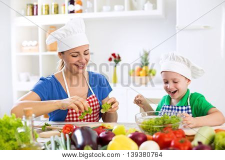 Family in kitchen prepare food funny time