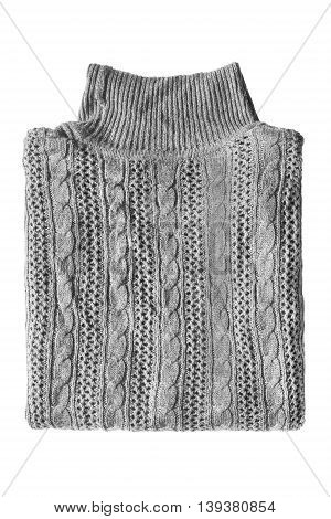 Folded gray knitted sweater isolated over white