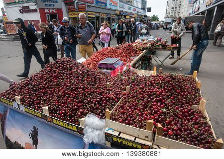 Saint-Petersburg Russia - June 22 2016: Shopping arcade with fruits and berries next to the metro station. Summer harvest cherries.