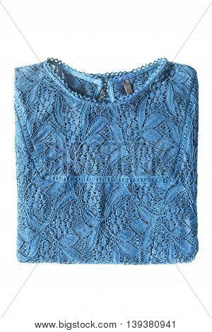 Folded blue lacy blouse on white background