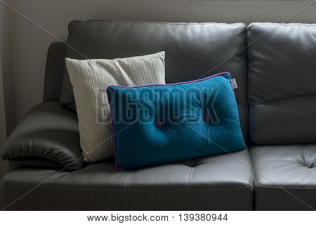 brown  Sofa and brown Pillow in home