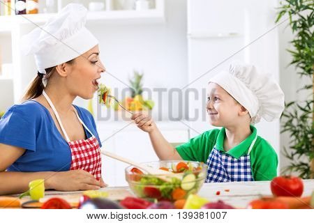 Child Giving To His Mother Fresh Healthy Food