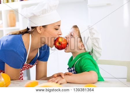 Mother And Son Eating Together Red Fresh Apple