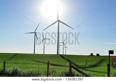 Wind turbine energy generating electricity on the plains