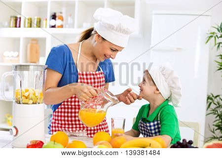 Mother With Healthy Orange Juice And Her Happy Little Child