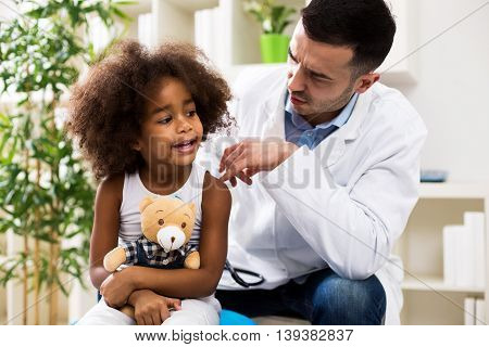 Pediatrician Talking With His Small Patient