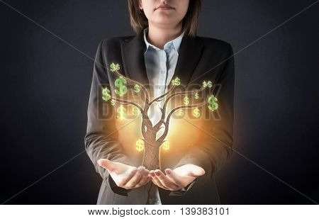 Business woman and money tree high quality studio shot